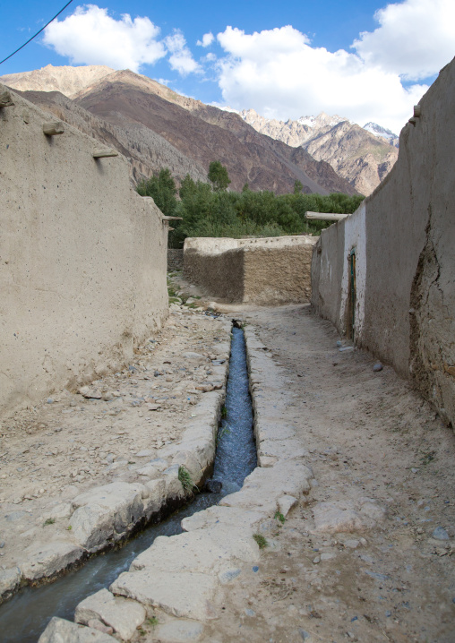 Street with water running in an old adobe village, Badakhshan province, Khandood, Afghanistan