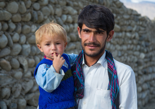 Portrait of an afghan boy with blonde hair with his father, Badakhshan province, Khandood, Afghanistan