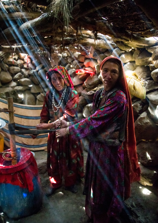 Wakhi nomad women making butter in the pamir mountains, Big pamir, Wakhan, Afghanistan