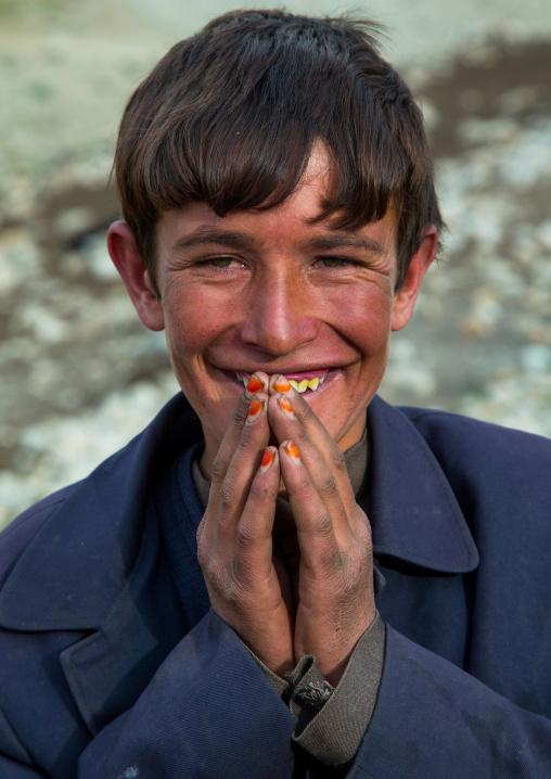 Smiling wakhi teenage boy with henna on his nails, Big pamir, Wakhan, Afghanistan