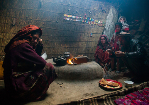 Wakhi nomad family eating breakfast inside their yurt, Big pamir, Wakhan, Afghanistan