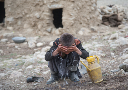 Wakhi boy washing his face in the early morning, Big pamir, Wakhan, Afghanistan