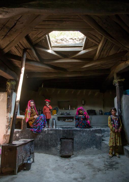 Afghan family inside their traditional pamiri house, Badakhshan province, Wuzed, Afghanistan