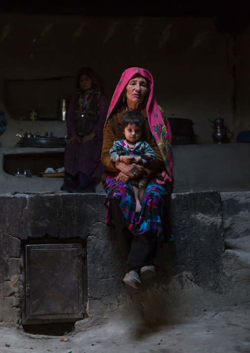 Afghan mother and her daughter inside their traditional pamiri house, Badakhshan province, Wuzed, Afghanistan