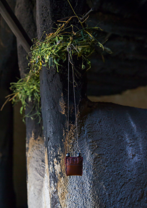 First grass cut of the year tied to a pilar in a pamiri house to bring luck, Badakhshan province, Wuzed, Afghanistan