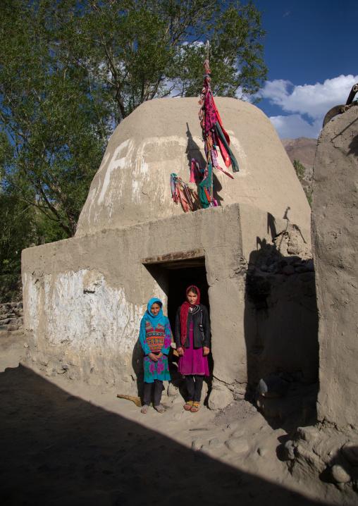 Afghan girls in front of an old muslim shrine, Badakhshan province, Khandood, Afghanistan