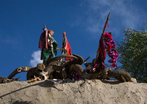 Flags and ibex horns on the top of an old shrine, Badakhshan province, Khandood, Afghanistan
