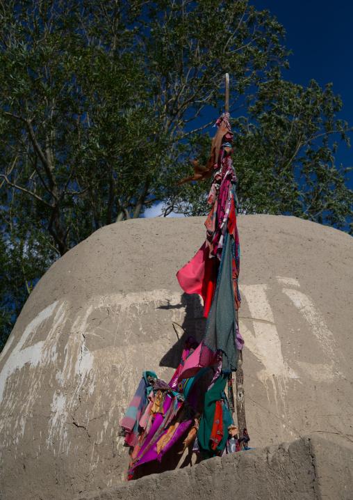 Flags on the top of an old shrine, Badakhshan province, Khandood, Afghanistan