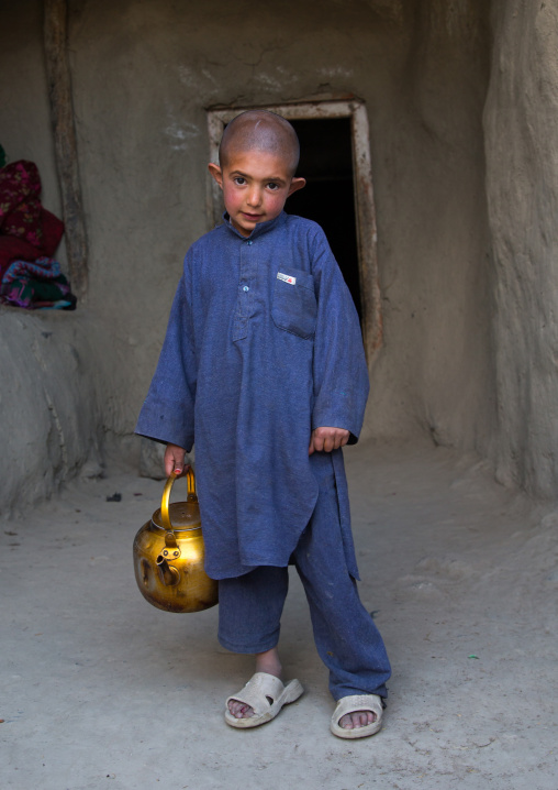 Afghan boy with shaved head, Badakhshan province, Khandood, Afghanistan