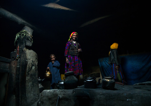 Afghan family inside their traditional pamiri house, Badakhshan province, Khandood, Afghanistan