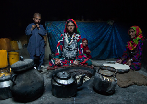 Afghan woman making bread inside her traditional pamiri house, Badakhshan province, Khandood, Afghanistan