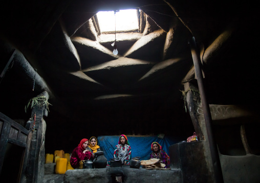 Afghan family inside their traditional pamiri house, Badakhshan province, Khandood, Afghanistan