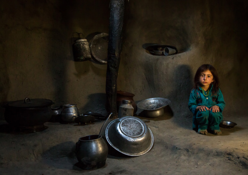 Afghan girl inside a traditional pamiri kitchen, Badakhshan province, Khandood, Afghanistan