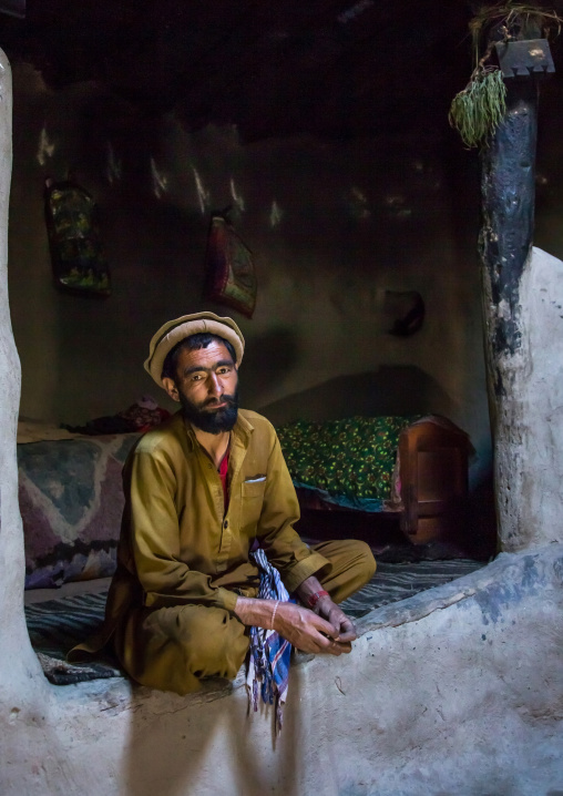 Afghan man inside his traditional pamiri house, Badakhshan province, Khandood, Afghanistan