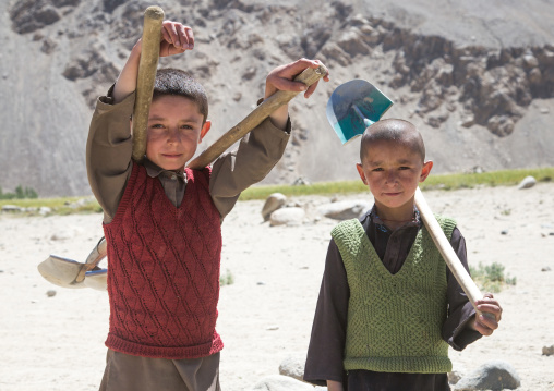 Afghan boys working on a road, Badakhshan province, Khandood, Afghanistan