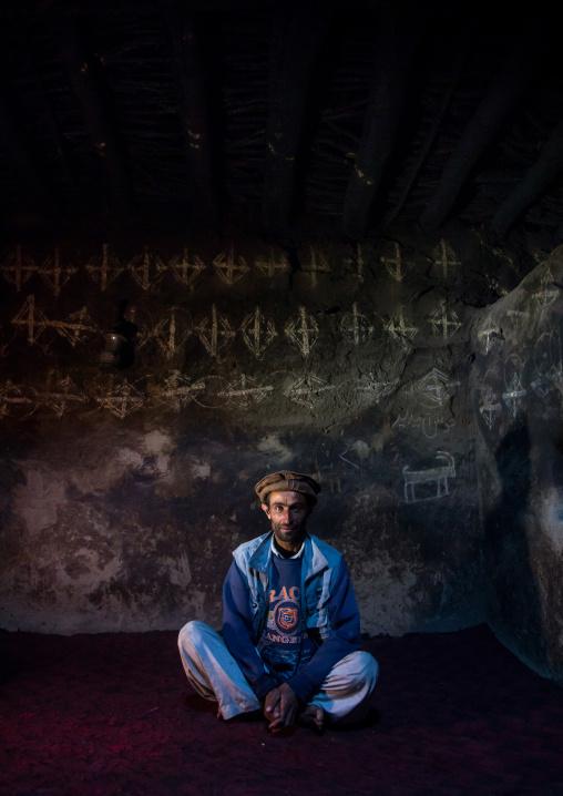 Afghan man sit inside his traditional pamiri house decorated for nowruz, Badakhshan province, Qazi deh, Afghanistan
