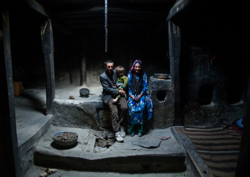 Afghan family inside their traditional pamiri house, Badakhshan province, Qazi deh, Afghanistan