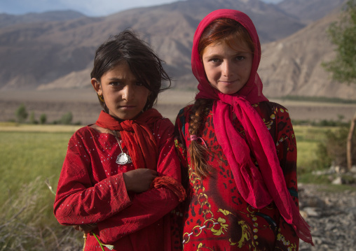 Portrait of afghan girls dressed in red clothes, Badakhshan province, Qazi deh, Afghanistan
