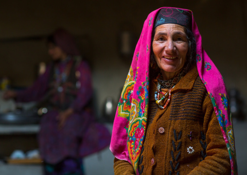 Portrait of an afghan woman in pamiri traditional clothing, Badakhshan province, Wuzed, Afghanistan