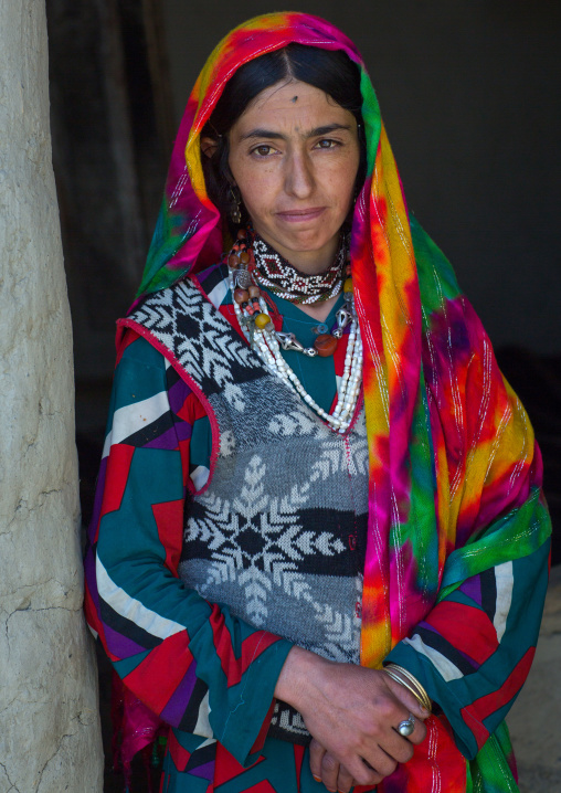 Portrait of an afghan woman in traditional clothing from pamir area, Badakhshan province, Khandood, Afghanistan