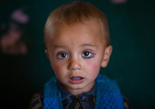 Portrait of an afghan boy with khol on one eye, Badakhshan province, Zebak, Afghanistan