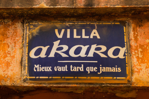 "Benin, West Africa, Porto-Novo, villa akara panel with the name of the house and a french proverb below ""better late than never"""