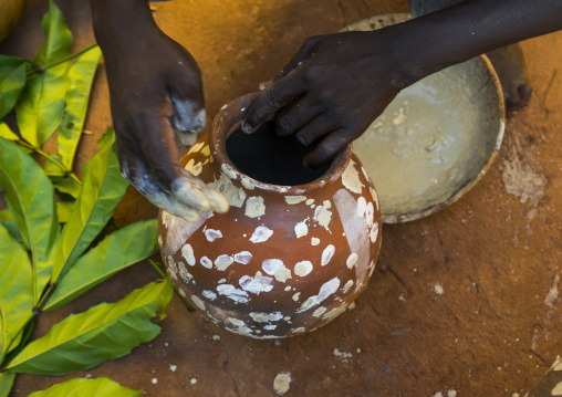 Benin, West Africa, Bonhicon, kagbanon bebe voodoo priest during a ceremony drawing white spots on a pot