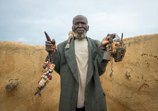 Benin, West Africa, Boukoumbé, mr kouagou maxon showing his voodoo magic healer fetishes