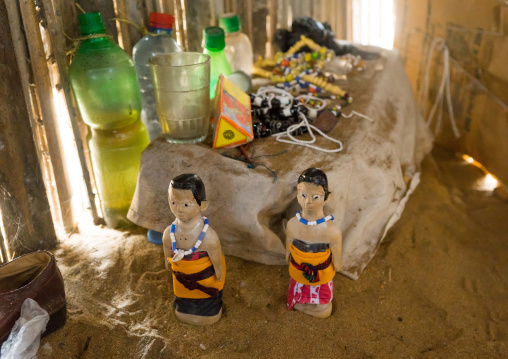 Benin, West Africa, Ouidah, carved wooden figures made to house the soul of dead twins inside a house