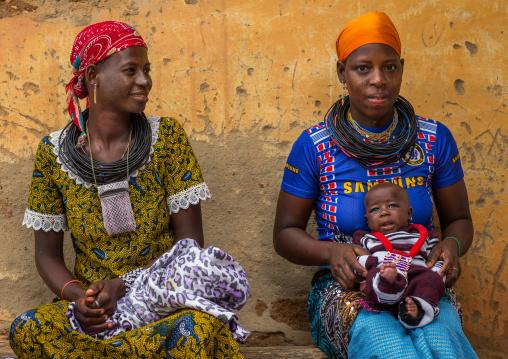 Benin, West Africa, Copargo, beautiful tattooed fulani peul tribe women with a baby