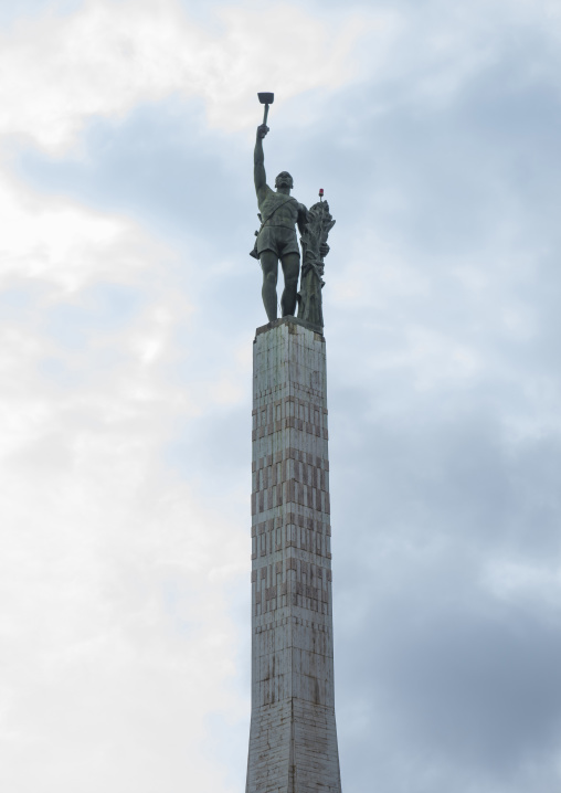 Benin, West Africa, Cotonou, red star square column and statue