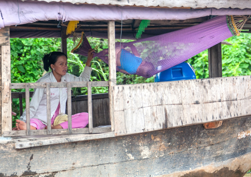 Cambodian mother with her baby in a hammock in the floating village on Tonle Sap lake, Siem Reap Province, Chong Kneas, Cambodia