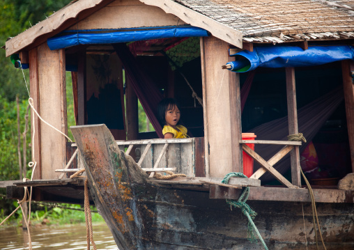 Cambodian girl in her house in the floating village on Tonle sap lake, Siem Reap Province, Chong Kneas, Cambodia