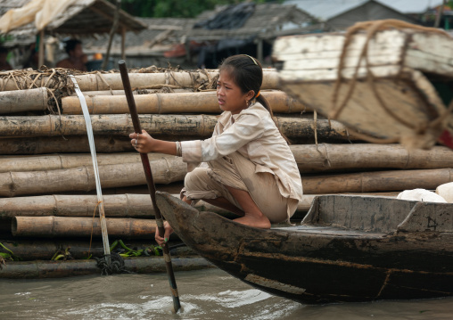 Cambodian girl on a boat in the floating village on Tonle Sap lake, Siem Reap Province, Chong Kneas, Cambodia