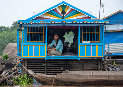 Cambodian woman standing at the door of her house in the floating village on Tonle Sap lake, Siem Reap Province, Chong Kneas, Cambodia