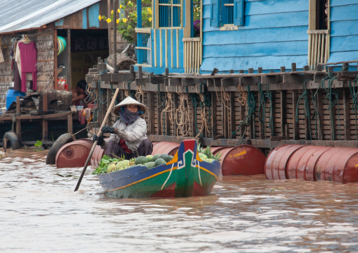 Cambodian woman selling food on boat in the floating village on Tonle Sap lake, Siem Reap Province, Chong Kneas, Cambodia
