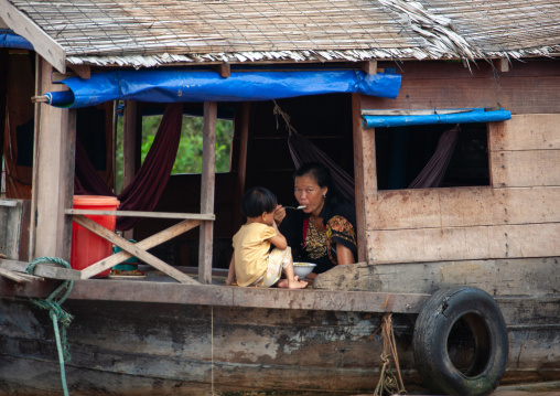 Cambodian people eating in their house in the floating village on Tonle Sap lake, Siem Reap Province, Chong Kneas, Cambodia