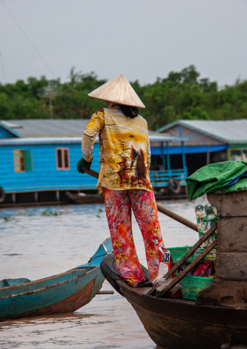 Cambodian woman rowing in the floating village on Tonle Sap lake, Siem Reap Province, Chong Kneas, Cambodia