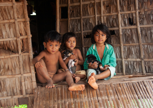 Cambodian children in the floating village on Tonle Sap lake, Siem Reap Province, Chong Kneas, Cambodia