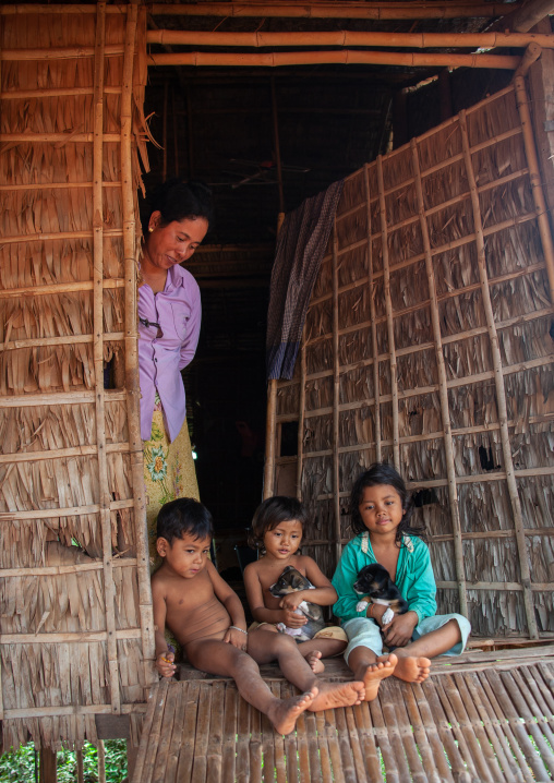 Cambodian woman with her children in the floating village on Tonle Sap lake, Siem Reap Province, Chong Kneas, Cambodia