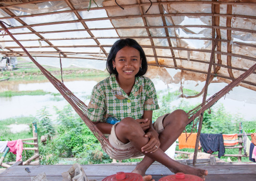 Cambodian girl on a hammock in the floating village on Tonle Sap lake, Siem Reap Province, Chong Kneas, Cambodia