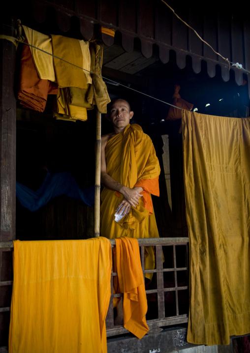 Cambodian monk in a monastery with robes drying, Battambang province, Battambang, Cambodia