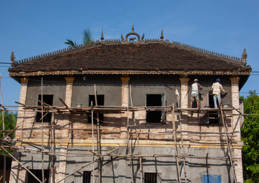 Cambodian workers renovating an old colonial house, Battambang province, Battambang, Cambodia