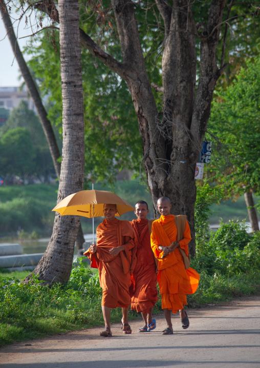 Cambodian monk walking in the street with umbrella, Battambang province, Battambang, Cambodia