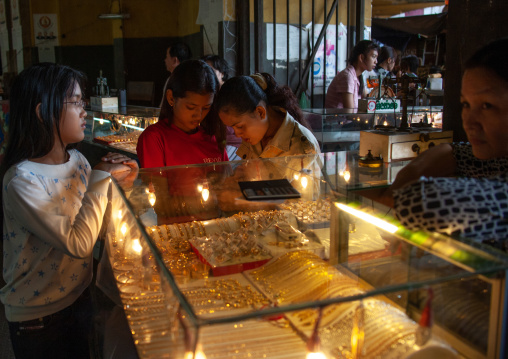 Cambodian women looking at gold jewelry in a market, Phnom Penh province, Phnom Penh, Cambodia