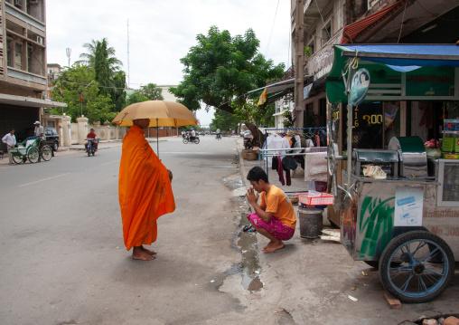 Buddhist monk begging on a street, Phnom Penh province, Phnom Penh, Cambodia