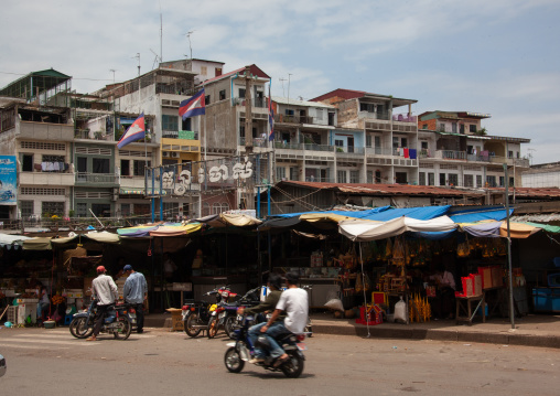 Market stalls in front of old colonial buildings, Phnom Penh province, Phnom Penh, Cambodia