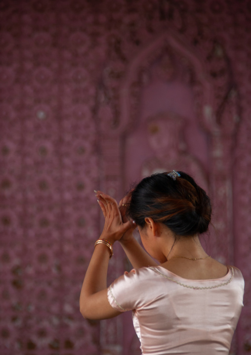 Cambodian dancer praying before a training session of the National ballet, Phnom Penh province, Phnom Penh, Cambodia