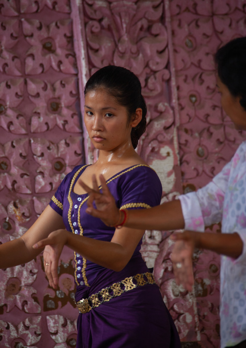 Cambodian dancer with her teacher during a training session of the National ballet, Phnom Penh province, Phnom Penh, Cambodia