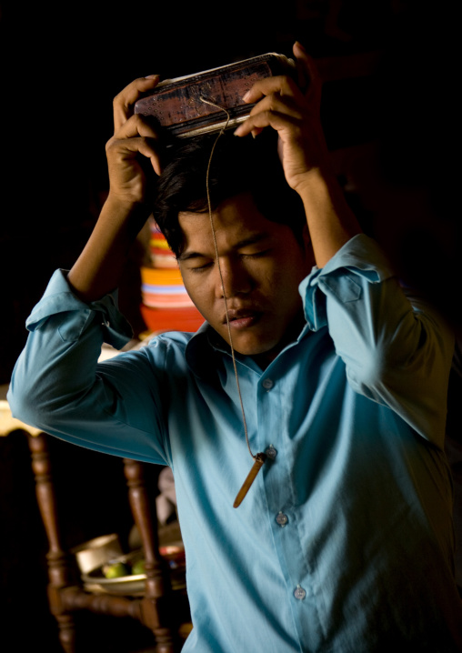 Cambodian man praying in a temple, Phnom Penh province, Phnom Penh, Cambodia